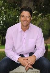 James Scott in a pink shirt