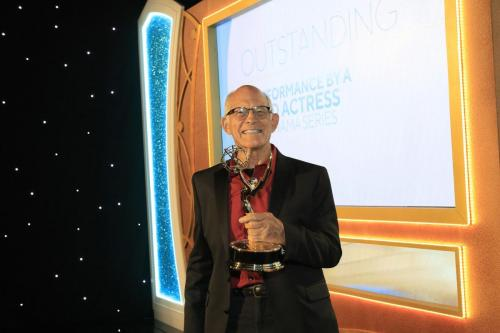 Max Gail strikes a pose with his Emmy backstage.