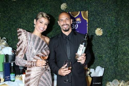 Real life love-birds Y&R's Brytni Sarpi  and Bryton James with some Lorenza Rose Wine from the gifting area.