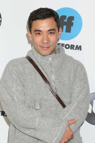 "Conrad Ricamora takes to the press line representing, ""How To Get Away with Murder""."