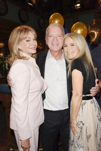 EP Ken Corday flanked by legacy stars Deidre Hall and Melissa Reeves.