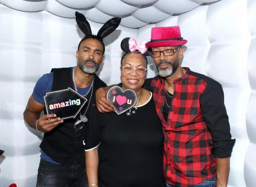 Donnell Turner alongside his mother Lorraine and his brother EJ with some fun hats during his annual event.