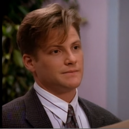 Matt Fielding (Doug Savant) was the openly gay character on Melrose Place. The show focused on his problems in the workplace, etc.  The scene where Matt kissed a man was cut.