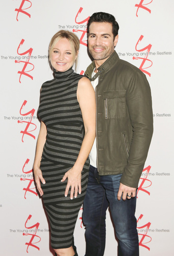Sharon Case and Jordi Vilasuso strike a pose.