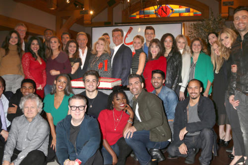 Tony Morina new EP flanked by Josh Griffith, who has returned to Y&R as head writer, with the cast at the #1 celebration.