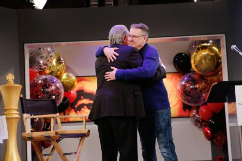 Y&R head writer and EP, Josh Griffith hugs Eric on his milestone.
